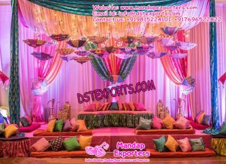 Mehandi Ceremony Decoration With Cushions and Umbrellas