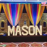 Colorful Wedding Mehndi Stage Setup With Statues